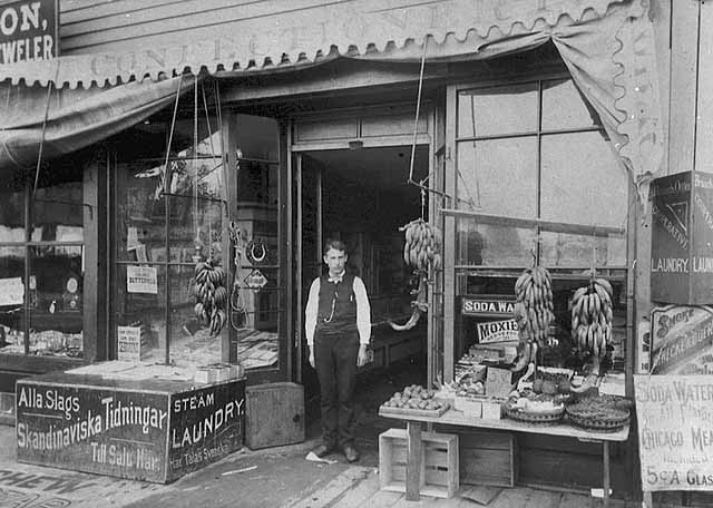 charles samuelson in front of Samuelson's, seven corners, mhs
