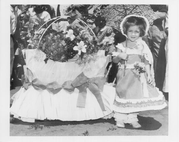 M2372, girl who won first prize in doll buggy parade at powderhorn park, 1937, hclib, fourth of july, smaller version
