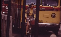 documerica photo of nicollet mall, woman on bike plus bus